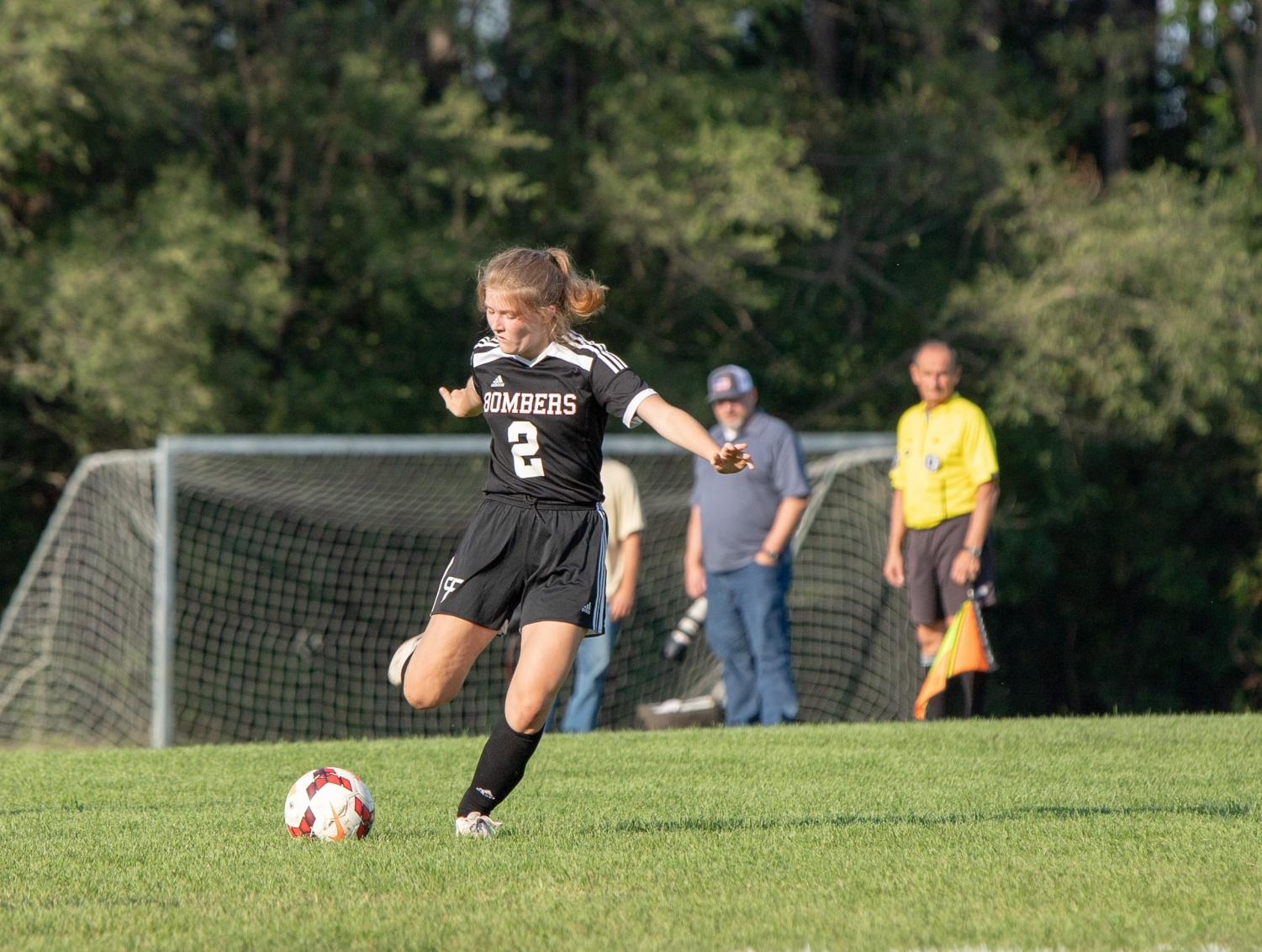 Anna Giese winds up to take one of her trademark free kicks.