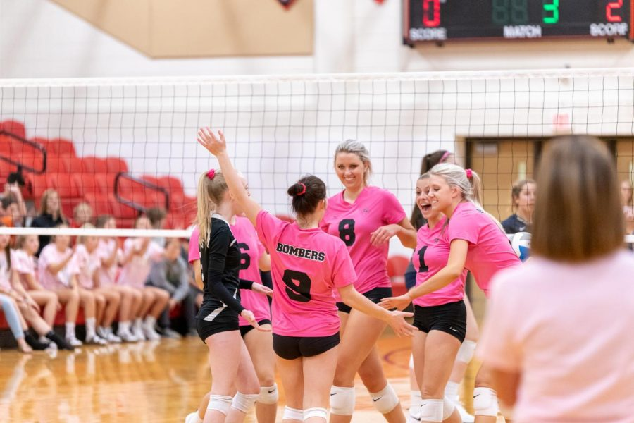 Pink+jerseys+were+worn+to+support+the+fight+against+cancer+during+the+homecoming+volleyball+game.