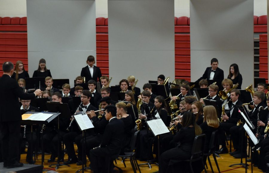 Mike legvold directs the high school band during an evening full of musical performances.