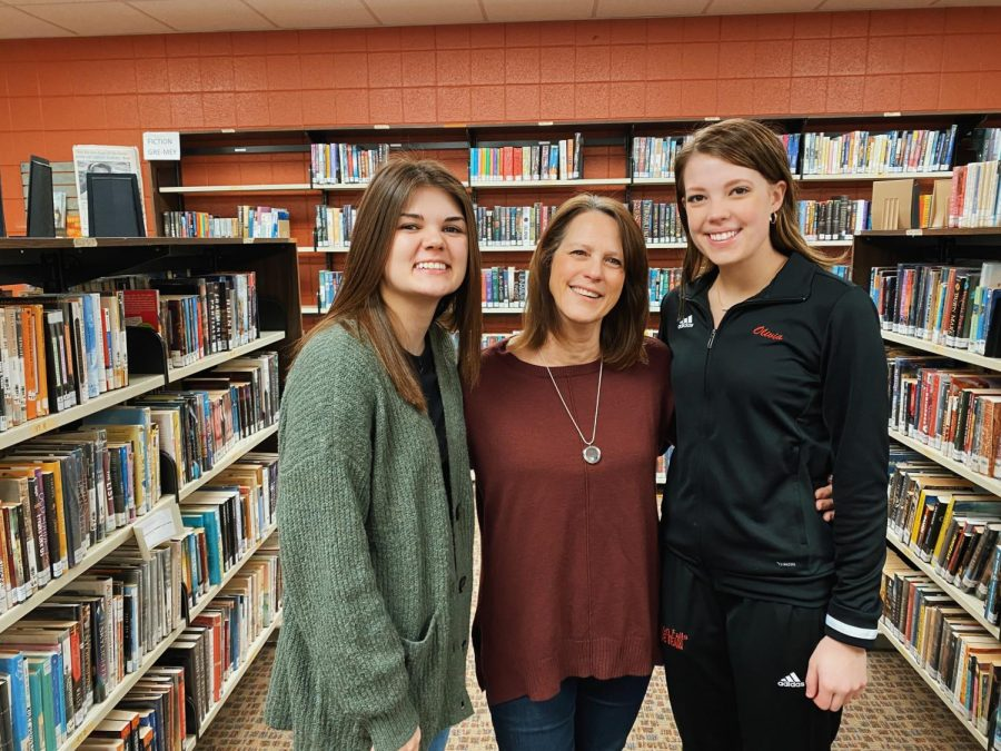 Senior Cannorama Editors-in-Chiefs ,Emma Conway and Olivia Johnson, posed for a photo with their Adviser, Cindy DeRosier (midde).