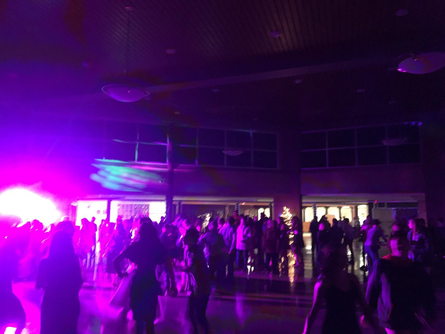 Under colorful lights, middle schoolers danced with one another.