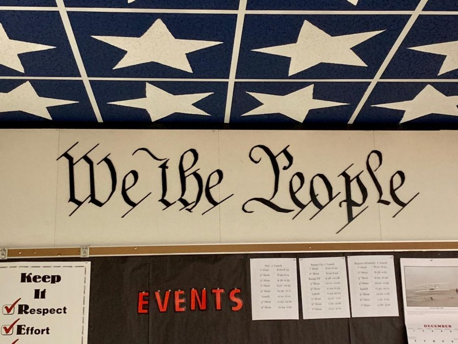 A sign dedicated We the People is displayed in Mrs. Loeschkes classroom.