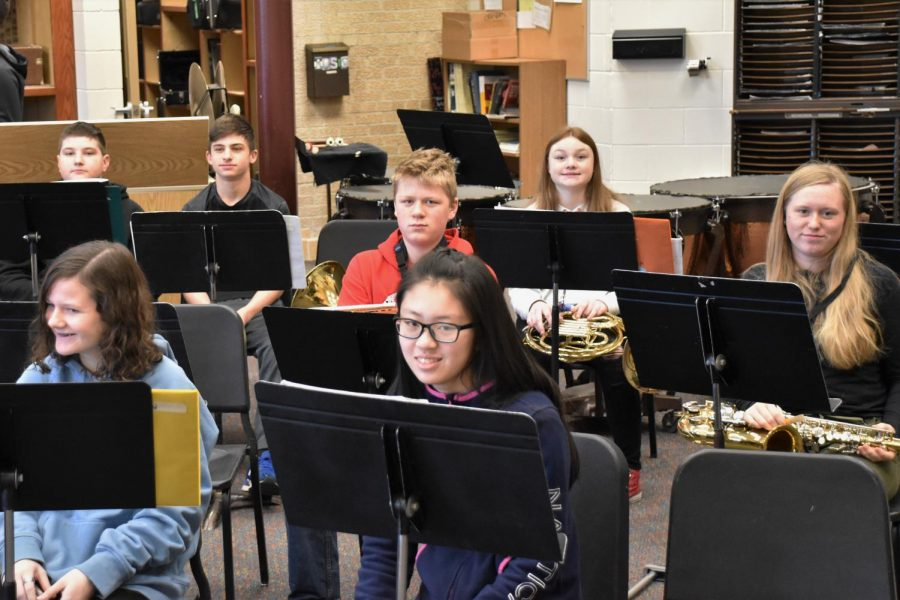 Middle school band members prepare for their next concert