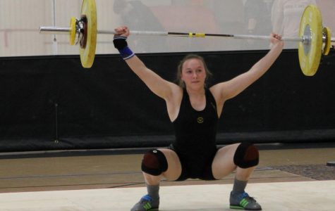 Senior Ellie Stodden concentrates on a lift at the home tournament.