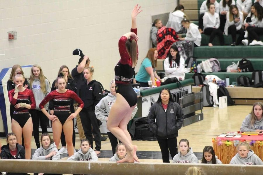 Saundra+Stodden+performs+her+beam+routine+at+a+recent+competition.