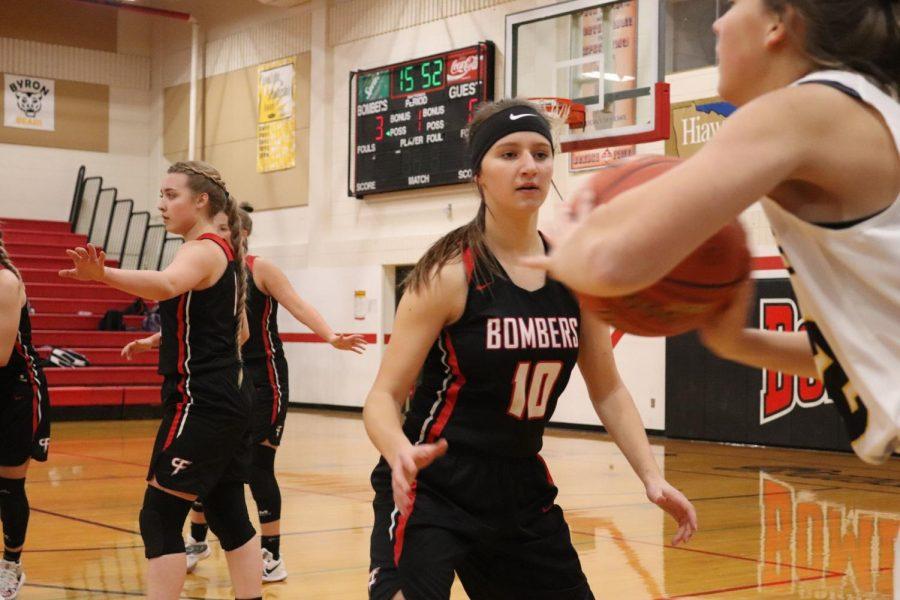 Bella Davisson puts some pressure on the opposing point guard