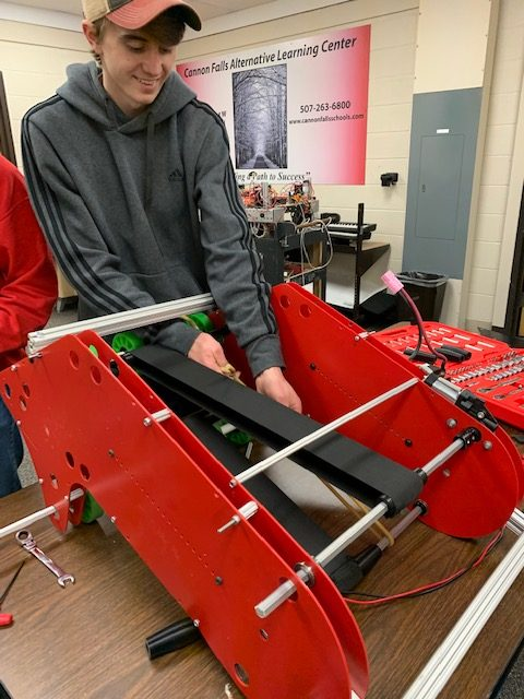 Design Captain, Blake Hernke, works on a prototype after school.