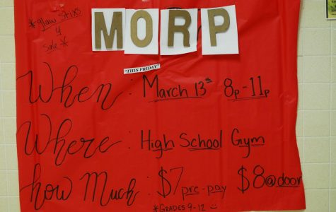 A bright, colorful poster to go with a bright, colorful event hangs in the high school hallway, as are several others.