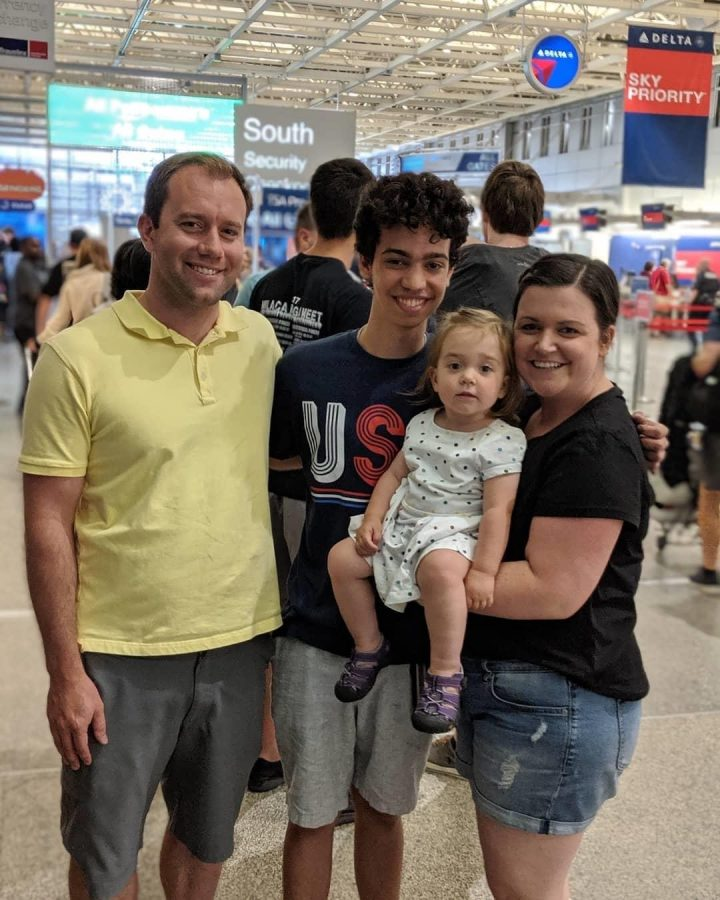 The+Yackels+and+Souza+%28middle%29+took+a+family+photo+at+the+airport+before+the+18-year-old+headed+back+to+Brazil+in+June+of+2019.+