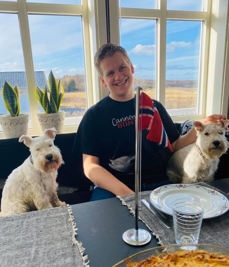 Although back in Norway, Aadde was pure smiles next to his two dogs on April 1.