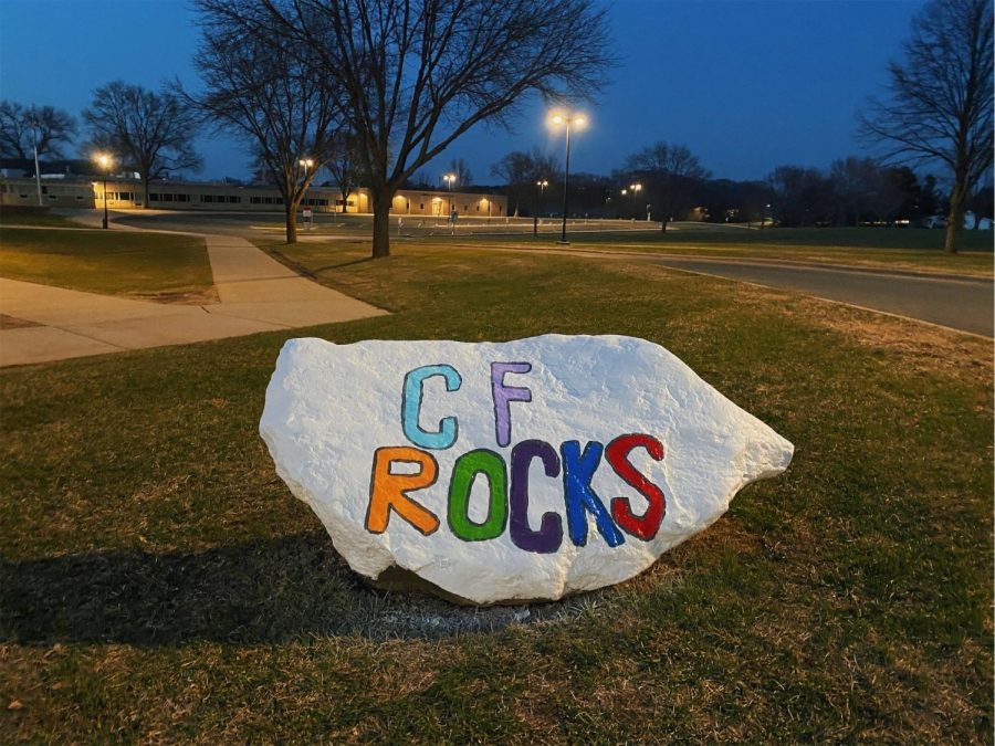 While keeping thier distance, The Lantern's Writing Editors-in-Chief got permission to paint the spirit rock in front of the school.