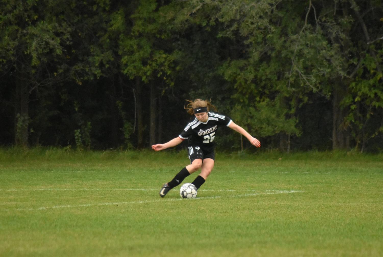 Senior Bella Davisson takes a goal kick during a home game against Kasson-Mantorville.