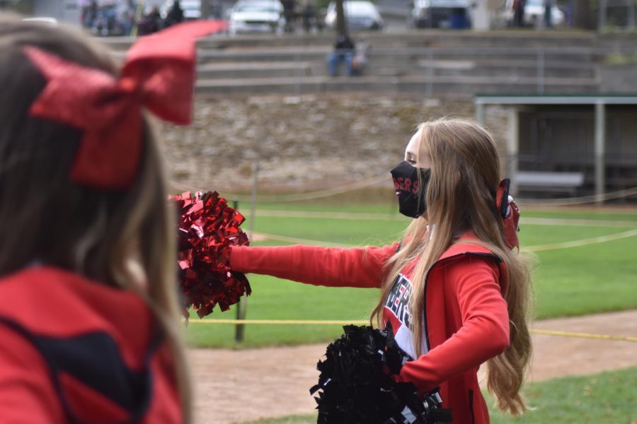 Captain Amelia Qualey leads the squad in a cheer during a Bomber home game.