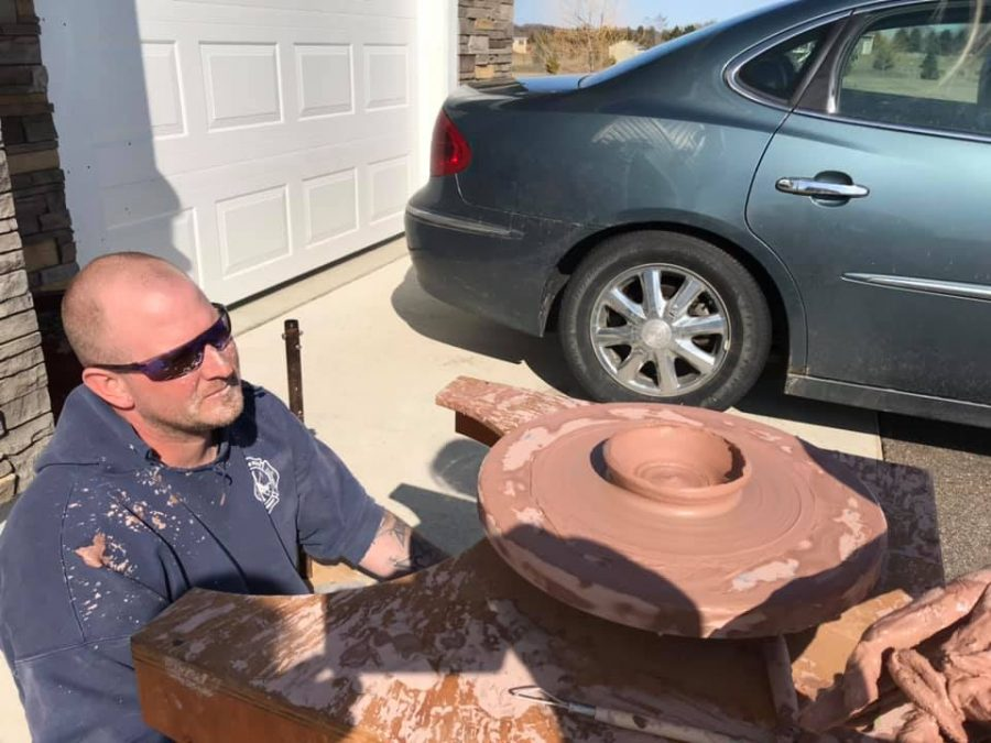 Ryan Qualey helps his daughter, Amelia Qualey, adapt to the pandemic by building her a ceramics wheel for her art classes.