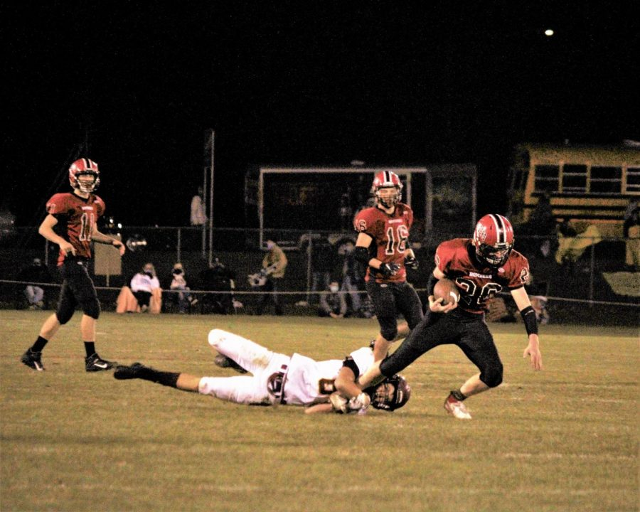 One of the Bombers' talented offensive athletes runs the ball forward during a home game.