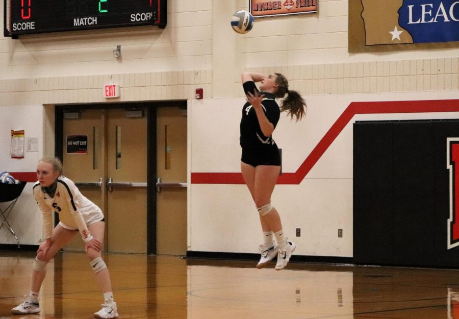 Makayla Bowen gets up in the air for a serve