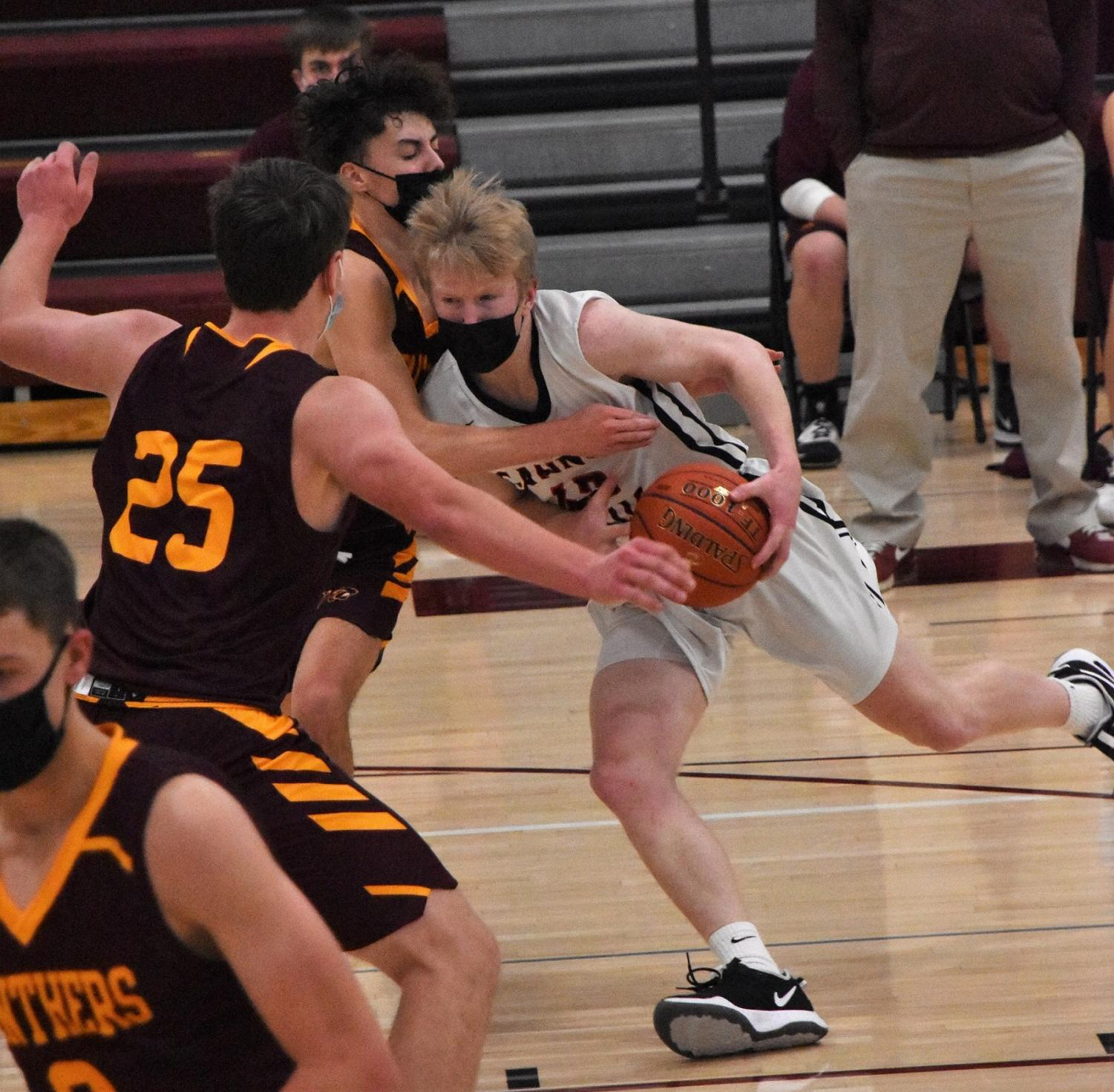 Bomber guard Jacob Wulf slashes toward the basket in a game against Pine Island