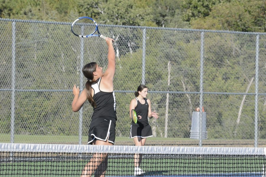 Doubles+team%2C+Hannah+Hjellming+and+Lauren+Ritz%2C+prepare+for+their+sections+match.