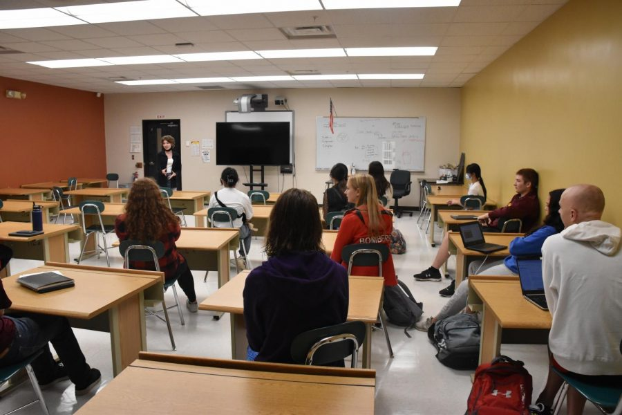 Senior Bianca Caputo discusses the environment with a roomful of eager club members.